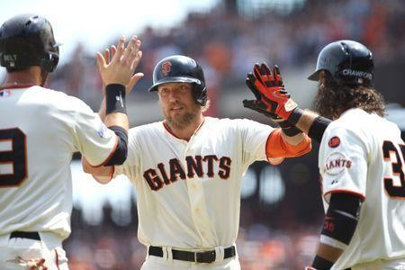 Aug 16, 2015; San Francisco, CA, USA; San Francisco Giants right fielder Hunter Pence (8) high fives first baseman Brandon Belt (9) and shortstop Brandon Crawford (35) after driving in Belt on a two run home run during the fourth inning against the Washington Nationals at AT&T Park. Mandatory Credit: Kelley L Cox-USA TODAY Sports