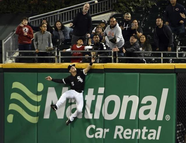 Chicago White Sox center fielder Adam Engel misses the ball and loses his glove on Shohei Ohtani's three-run home run. (AP)