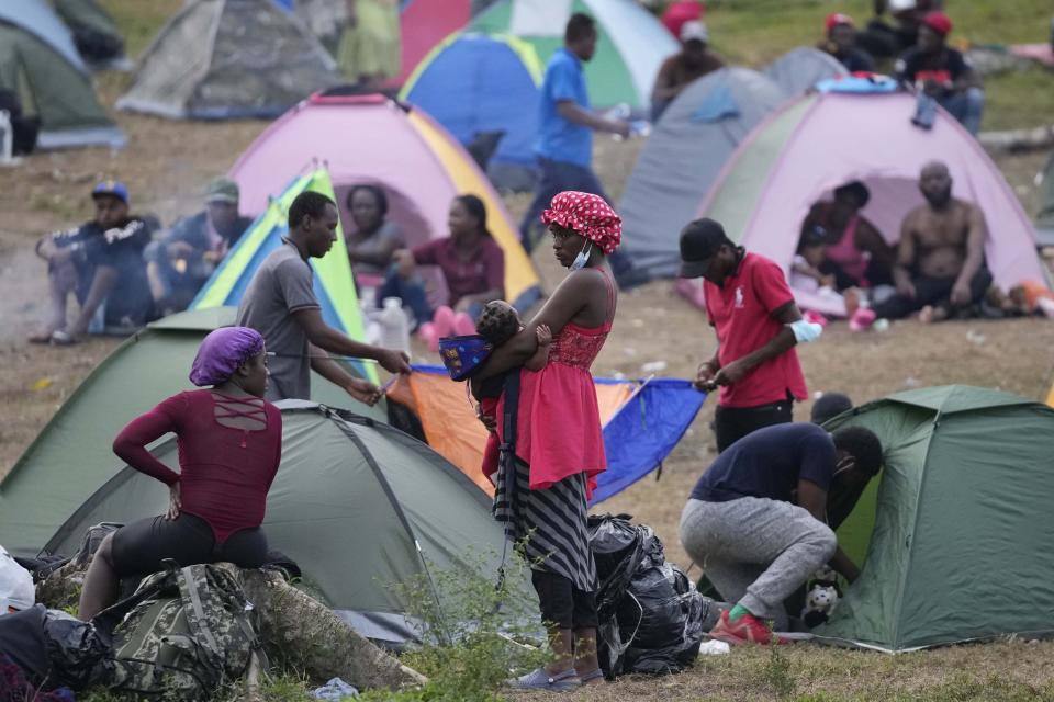 Migrants rest at a camp in Acandi, Colombia, Tuesday, Sept. 14, 2021. The migrants, following a well-beaten, multi-nation journey towards the U.S., will continue their journey through the jungle known as the Darien Gap. (AP Photo/Fernando Vergara)
