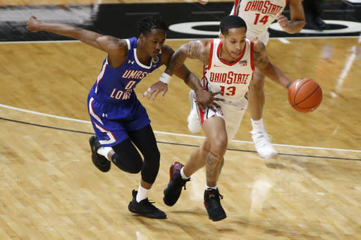 Ohio State's C.J. Walker, right, steals the ball from UMass-Lowell's Ron Mitchell during the first half of an NCAA college basketball game Sunday, Nov. 29, 2020, in Columbus, Ohio. (AP Photo/Jay LaPrete)
