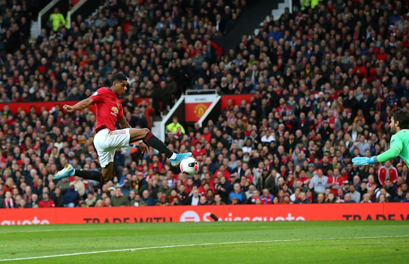 MANCHESTER, ENGLAND - OCTOBER 20: Marcus Rashford of Manchester United scores his sides first goal during the Premier League match between Manchester United and Liverpool FC at Old Trafford on October 20, 2019 in Manchester, United Kingdom. (Photo by Alex Livesey/Getty Images)