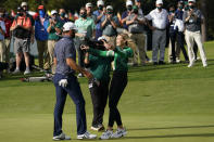 Dustin Johnson is hugged by Paulina Gretzky the Masters golf tournament Sunday, Nov. 15, 2020, in Augusta, Ga. (AP Photo/David J. Phillip)