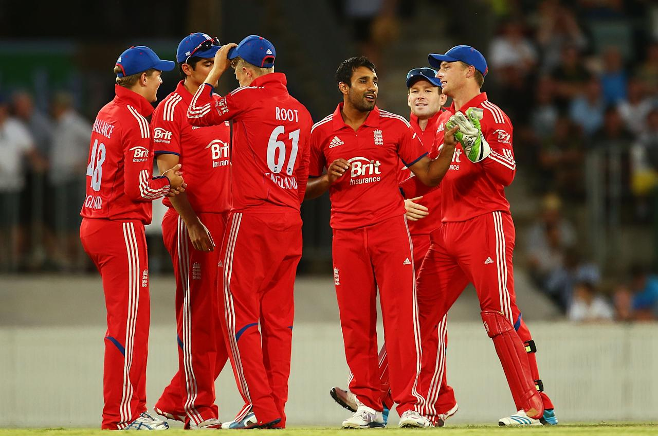 CANBERRA, AUSTRALIA - JANUARY 14:  Ravi Bopara of England is congratulated after taking a wicket during the International tour match between the Prime Minister's XI and England at Manuka Oval on January 14, 2014 in Canberra, Australia.  (Photo by Mark Nolan/Getty Images)
