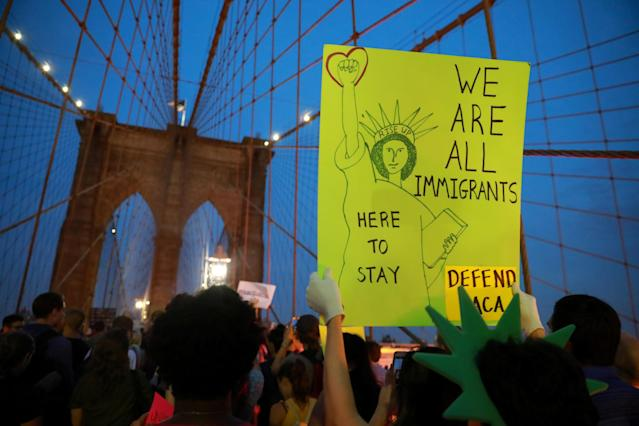 <p>People march across the Brooklyn Bridge to protest the planned dissolution of DACA in Manhattan, New York City, Sept. 5, 2017. (Photo: Stephen Yang/Reuters) </p>