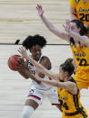 UConn guard Christyn Williams (13) is pressured by Iowa guard Gabbie Marshall (24) and guard Caitlin Clark (22) during the first half of a college basketball game in the Sweet Sixteen round of the women's NCAA tournament at the Alamodome in San Antonio, Saturday, March 27, 2021. (AP Photo/Eric Gay)