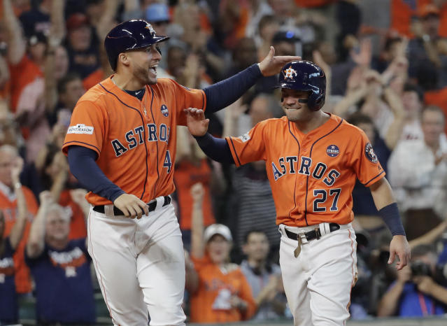George Springer and Jose Altuve celebrate another big day of offense. (AP)