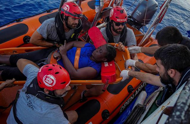 NBA Memphis player Marc Gasol and members of NGO Proactiva Open Arms rescue boat carry African migrant in central Mediterranean Sea, July 17, 2018. REUTERS/Juan Medina