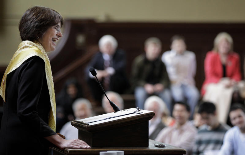 Princeton University economist and Dean of the Woodrow Wilson School of Public and International Affairs Christina Hull Paxson laughs as she tells a story about her brother during her introduction as the 19th President of Brown University in Providence, RI., Friday, March 2, 2012. (AP Photo/Stephan Savoia)