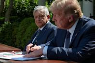 US President Donald Trump and Mexican President Andres Manuel Lopez Obrador sign a joint declaration in the Rose Garden of the White House
