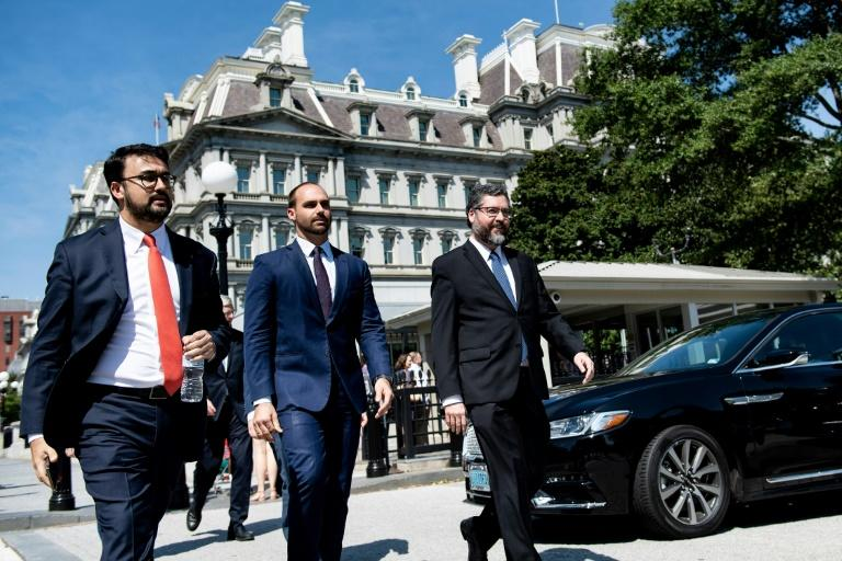 Brazilian Foreign Minister Ernesto Araujo (R) discussed the Amazon fires with Donald Trump at the White House, in a meeting also attended by President Jair Bolsonaro's son and hopeful ambassador to the United States, Eduardo (C) (AFP Photo/Brendan Smialowski)