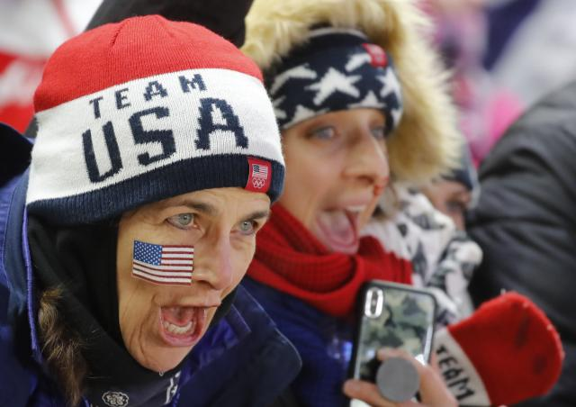 Skeleton - Pyeongchang 2018 Winter Olympics – Women's Finals - Olympic Sliding Center - Pyeongchang, South Korea – February 17, 2018 - Supporters of U.S. team react. REUTERS/Arnd Wiegmann