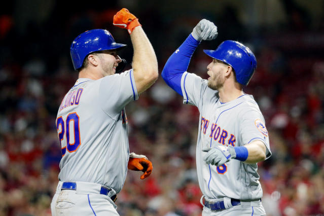 New York Mets' Pete Alonso, left, celebrates with Jeff McNeil, right, after hitting a two-run home run off Cincinnati Reds starting pitcher Sal Romano in the eighth inning of a baseball game Friday, Sept. 20, 2019, in Cincinnati. (AP Photo/John Minchillo)