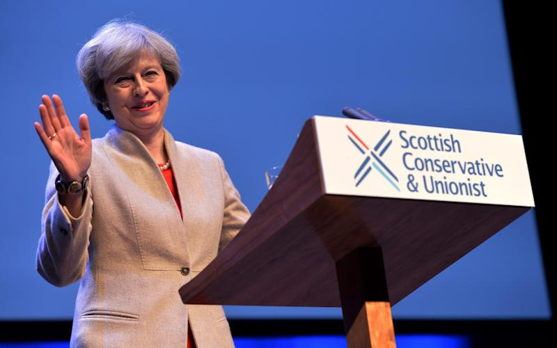 Jim McColl attended a fundraising dinner with Theresa May during her visit to Scotland last week - Credit: Getty