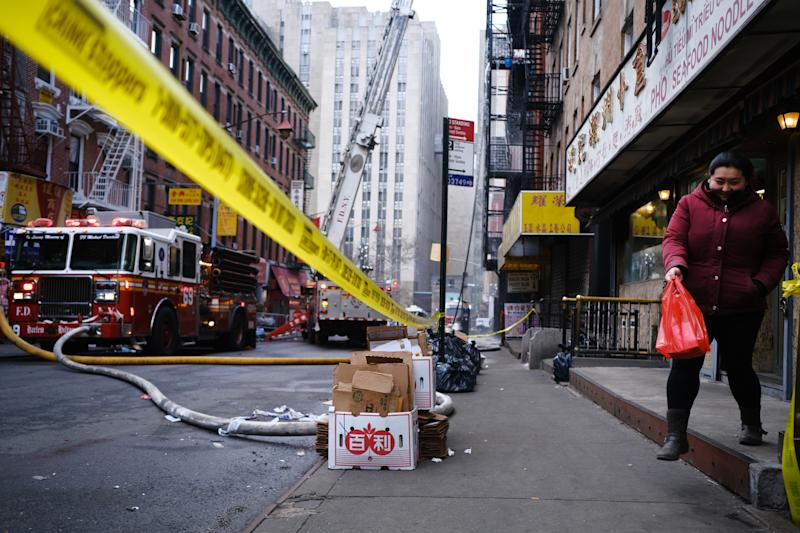 Five Alarm Fire Damages Building In New York's Chinatown
