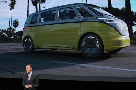 Dr. Herbert Diess, CEO, Volkswagen AG, speaks in front of an image of a van concept vehicle during the company's presentation at the North American International Auto Show in Detroit, Michigan, U.S., January 14, 2019. REUTERS/Jonathan Ernst