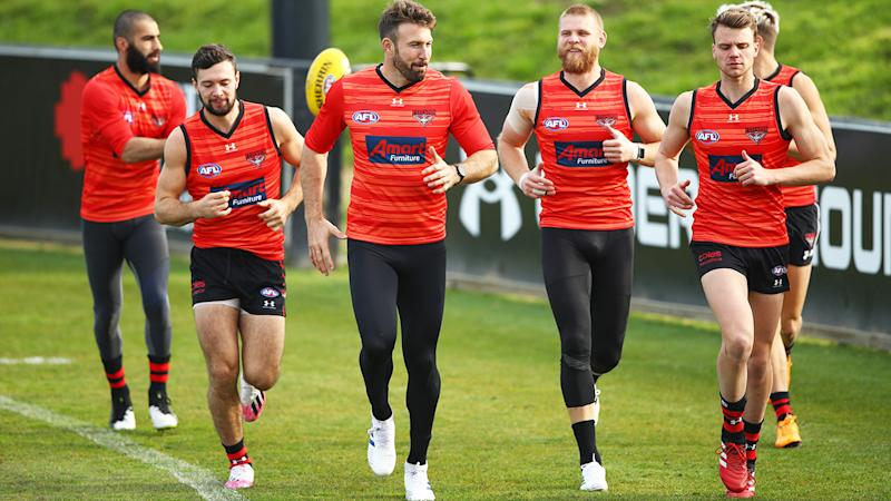 Conor McKenna, pictured here with some Essendon teammates at training.