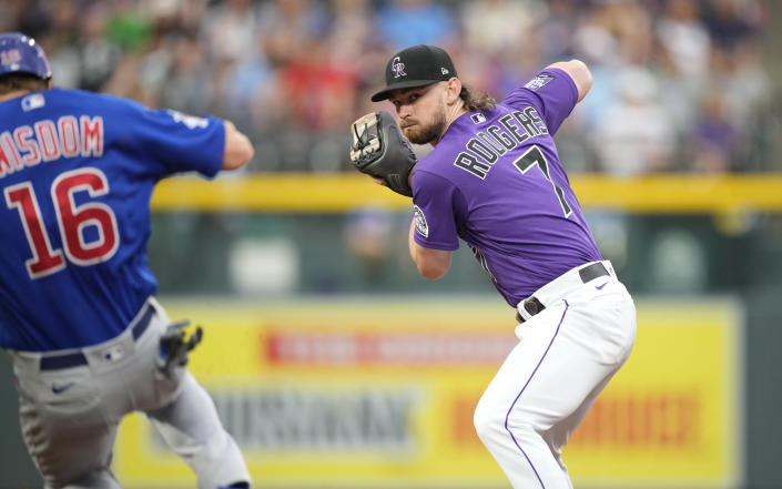 Colorado Rockies second baseman Brendan Rodgers, right, fields the throw to force out Chicago Cubs' Patrick Wisdom at second base on a ground ball hit by Ian Happ in the second inning of a baseball game Tuesday, Aug. 3, 2021, in Denver. (AP Photo/David Zalubowski)
