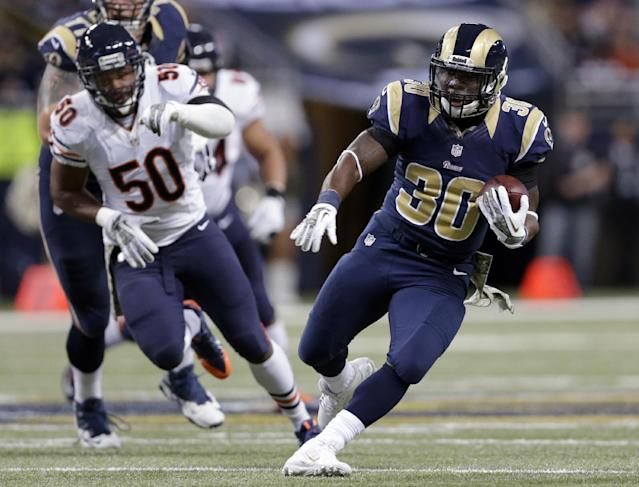 St. Louis Rams running back Zac Stacy, right, runs for a 35-yard gain as Chicago Bears linebacker James Anderson (50) pursues during the first quarter of an NFL football game on Sunday, Nov. 24, 2013, in St. Louis. (AP Photo/Nam Y. Huh)