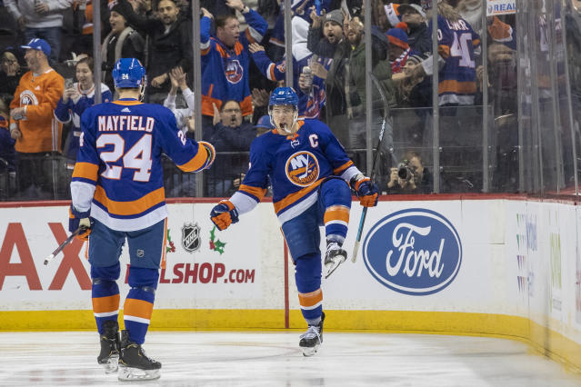 New York Islanders center Anders Lee (27) celebrates with defenseman Scott Mayfield (24) after scoring a goal during the first period of an NHL hockey game against the Columbus Blue Jackets, Saturday, Nov. 30, 2019, in New York. (AP Photo/Mary Altaffer)