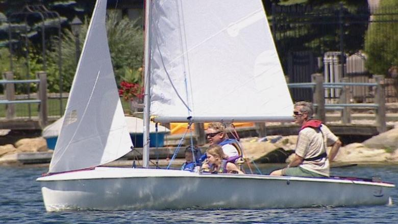 Low water levels at Glenmore Reservoir launch sailing roadshow