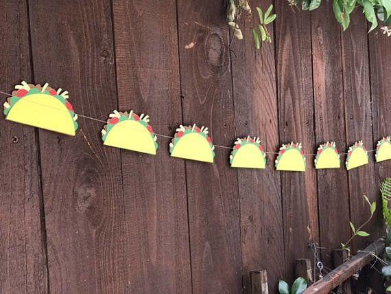 """<a href=""""https://www.etsy.com/listing/531465639/tacos-taco-garland-taco-tuesday-cinco-de?ga_order=most_relevant&ga_search_type=all&ga_view_type=gallery&ga_search_query=tacos&ref=sr_gallery_26"""" target=""""_blank"""">Shop it here</a>."""