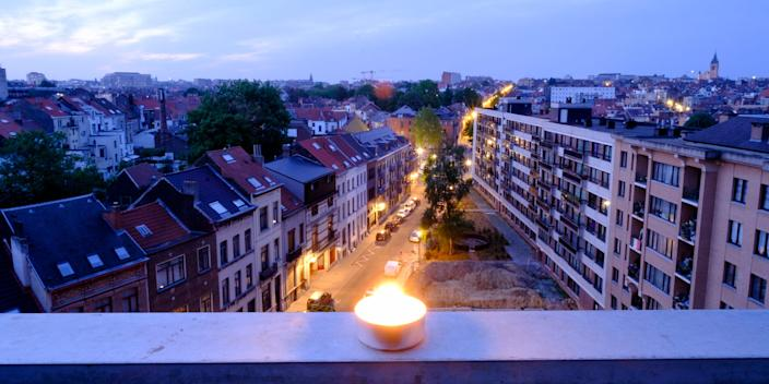 A candle is lighted on a balcony on May 9, 2020 in Brussels, Belgium. Darkness Into Light Brussels, a virtual #MomentofTogetherness in memory of those who have left us too soon by suicide, and in support of those of us who are living with mental health issues.