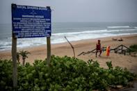 A shark warning notice board at Umgababa Beach near Durban