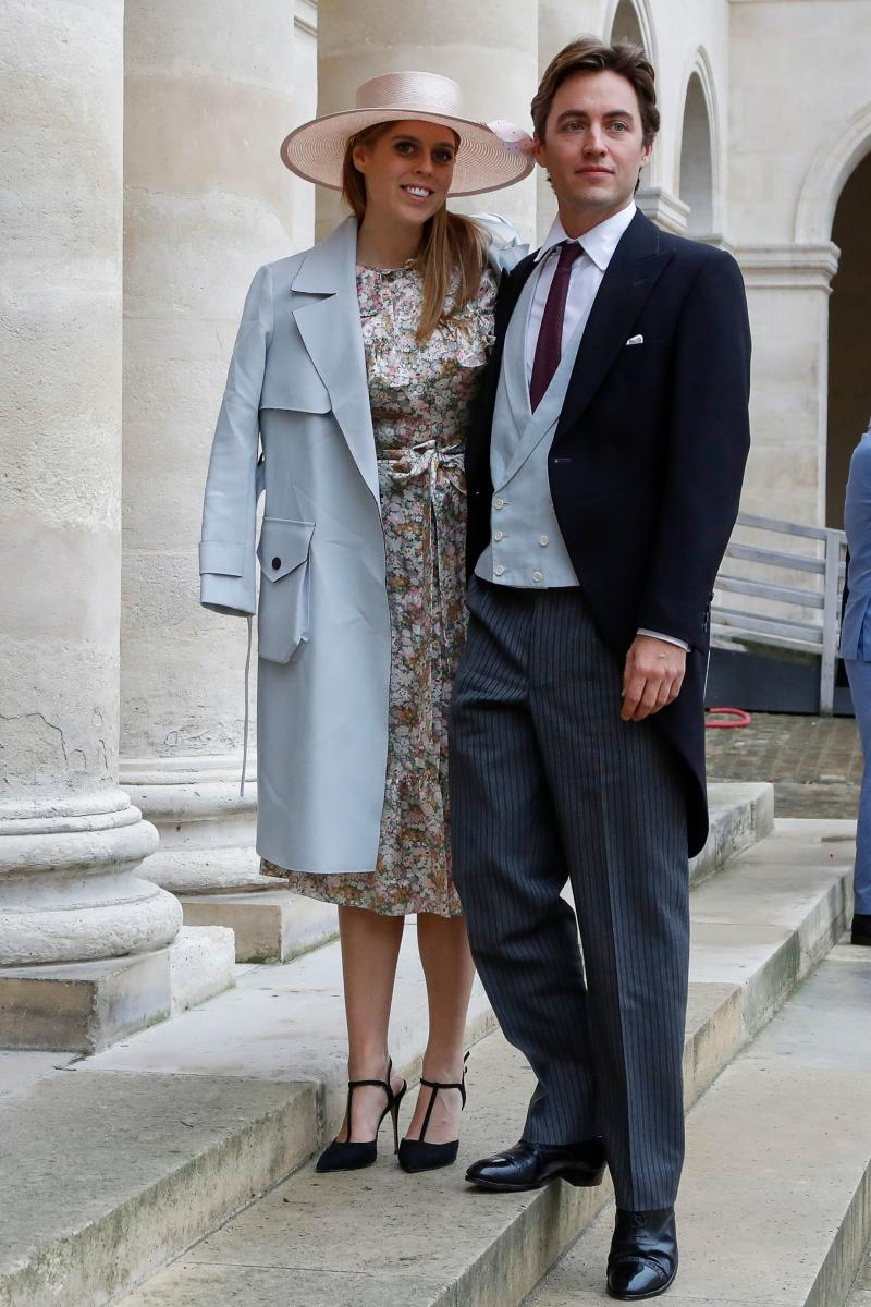Britain's Princess Beatrice and property tycoon Edoardo Mapelli Mozzi arrive to attend the wedding of prince Napoleon and Countess Olympia Arco-Zinneberg at the Saint-Louis-des-Invalides cathedral at the Invalides memorial complex in Paris on October 19, 2019.