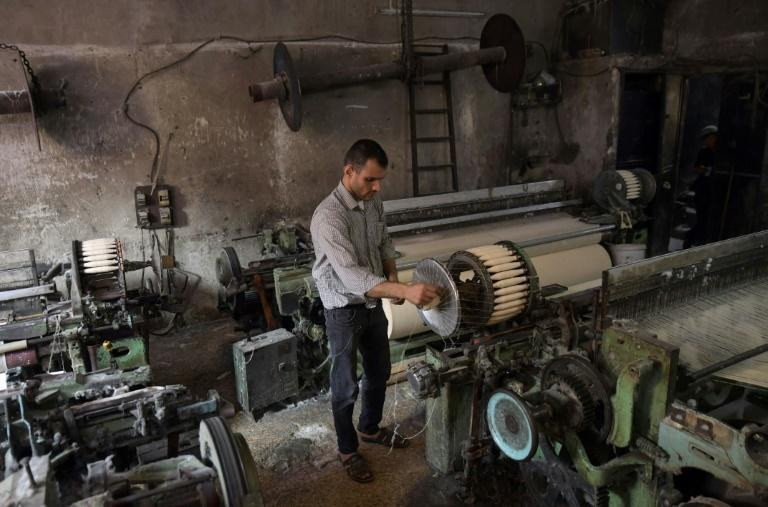 Syrian Mahmud Majkini toils in his workshop in the northern city of Aleppo (AFP/-)