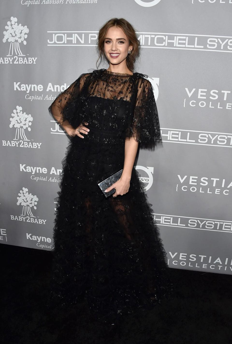 <p>Jessica's extravagant Valentino gown couldn't be missed, taking up a large portion of the black carpet. <i>[Photo: Getty]</i> </p>