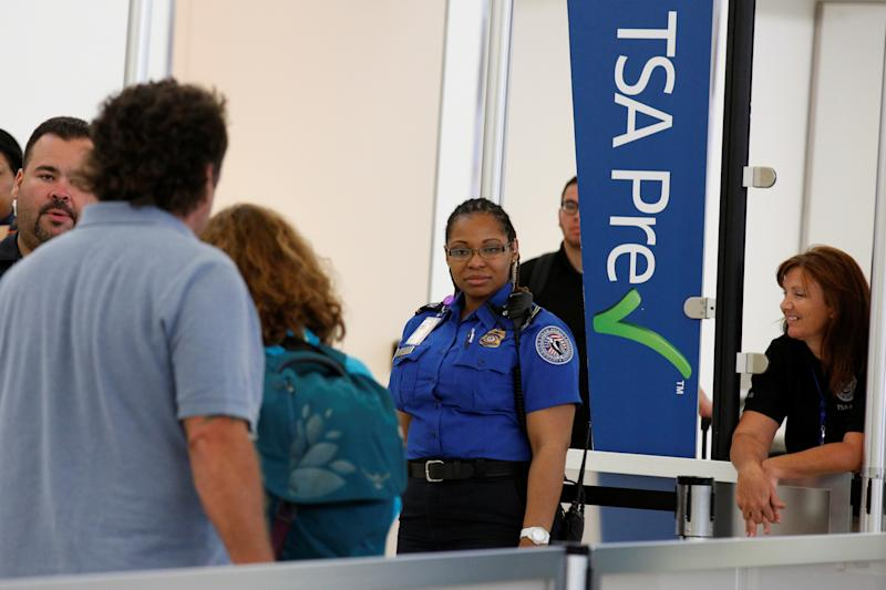 Transportation Security Administration (TSA) agents check-in passengers at JFK airport in the Queens borough of New York City, U.S., May 27, 2016.  REUTERS/Brendan McDermid