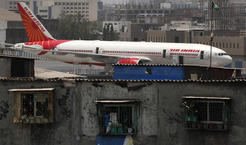 An Air India aircraft is parked at the Chhatrapati Shivaji international airport in Mumbai, India, Wednesday, May 9, 2012. A court on Wednesday declared a strike by some Air India pilots as illegal, triggered by unpaid salaries and a dispute on training on flying new generation B-787 Dreamliner aircraft. (AP Photo/ Rajanish Kakade)