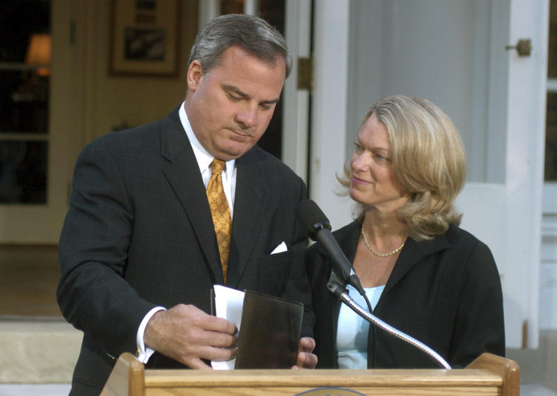 FILE - In this June 21, 2004 file photo, Connecticut Gov. John G. Rowland, with his wife Patty beside him, finishes his speech after he announced his resignation from office at the Governor's Residence in Hartford, Conn. Rowland eventually was sentenced to serve time in a federal prison, but again is in the crosshairs of federal investigators. On Monday, March 31, 2014, a former Republican Congressional candidate and her husband pleaded guilty in a scheme to create a phony contract to hide the consulting role Rowland played in her campaign. (AP Photo/Bob Child, File)