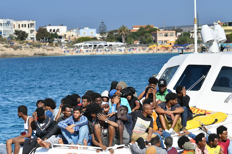 Migrants from Tunisia and Lybia arrive onboard of an Italian Guardia Costiera (Coast Guard) boat in the Italian Pelagie Island of Lampedusa on August 1, 2020. (Photo by Alberto PIZZOLI / AFP) (Photo by ALBERTO PIZZOLI/AFP via Getty Images) (Photo: ALBERTO PIZZOLI via Getty Images)