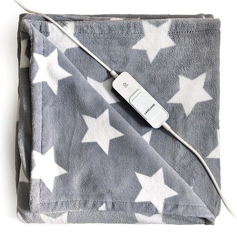 "<h3>Electric Blankets</h3><br>Electric <a href=""https://www.refinery29.com/en-gb/weight-blanket-review"" rel=""nofollow noopener"" target=""_blank"" data-ylk=""slk:blankets"" class=""link rapid-noclick-resp"">blankets</a> might feel like something you use when you go to stay at your grandma's but the old-school device is the perfect way to heat your home once it starts to get chilly. If you're searching for something to keep beds and sofas warm, then it's best to invest in a <a href=""https://www.lakeland.co.uk/26152/Dreamland-Single-Heated-Mattress-Protector-Quilted-Cotton?"" rel=""nofollow noopener"" target=""_blank"" data-ylk=""slk:warming mattress topper"" class=""link rapid-noclick-resp"">warming mattress topper</a> that comes with an inbuilt remote heating system. However, if you're just looking for something to keep you cosy while you work, opt for a lighter, fleece-lined blanket which you can wear while sitting at the computer. <br><br><strong>Lakeland</strong> Soft & Thick Star Heated Throw, $, available at <a href=""https://www.lakeland.co.uk/62822/Lakeland-Soft-%26-Thick-Star-Heated-Throw-"" rel=""nofollow noopener"" target=""_blank"" data-ylk=""slk:Lakeland"" class=""link rapid-noclick-resp"">Lakeland</a>"