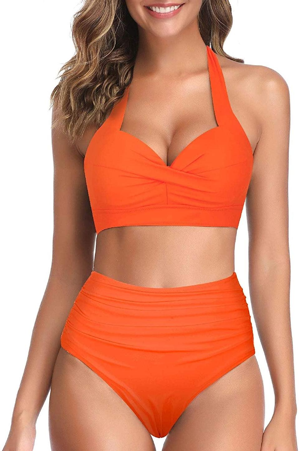 <p>This <span>Tempt Me Two Piece Retro Halter Ruched High Waist Bikini</span> ($32, originally $36) will provide ample coverage, while still looking sexy.</p>