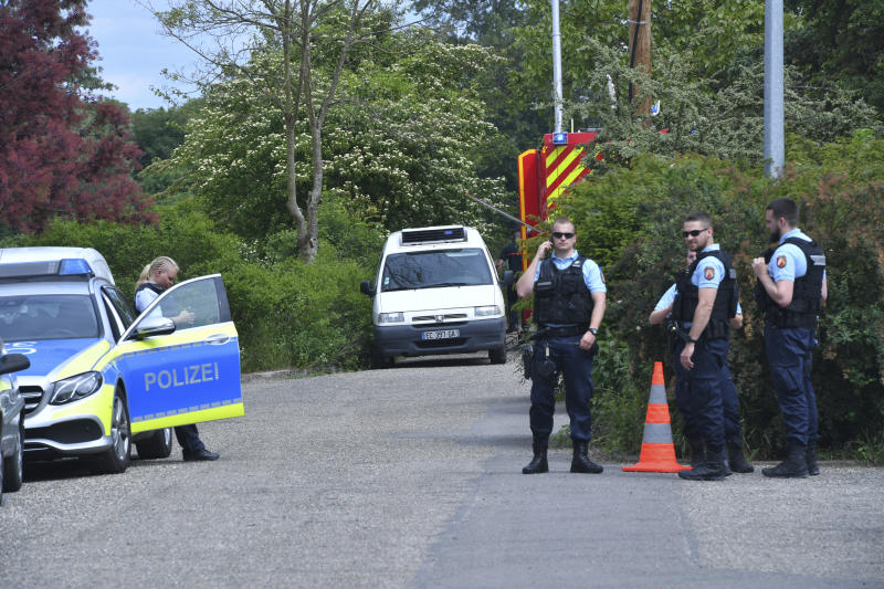German police officers wait near Gerstheim, eastern France, Thursday, May 30, 2019. Police say three people were killed and a child disappeared after a small boat capsized in the Rhine River between Germany and France. (AP Photo)