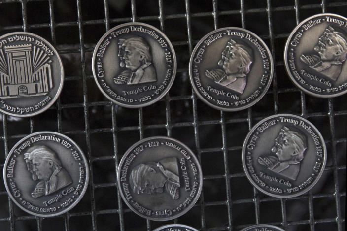 Coins with the images of U.S. President Donald Trump and King Cyrus, in honor of Trump's recognition of Jerusalem as the capital of Israel, are seen in a workshop coined in Tel Aviv on Feb. 28, 2018. (Photo: Sebastian Scheiner/AP)