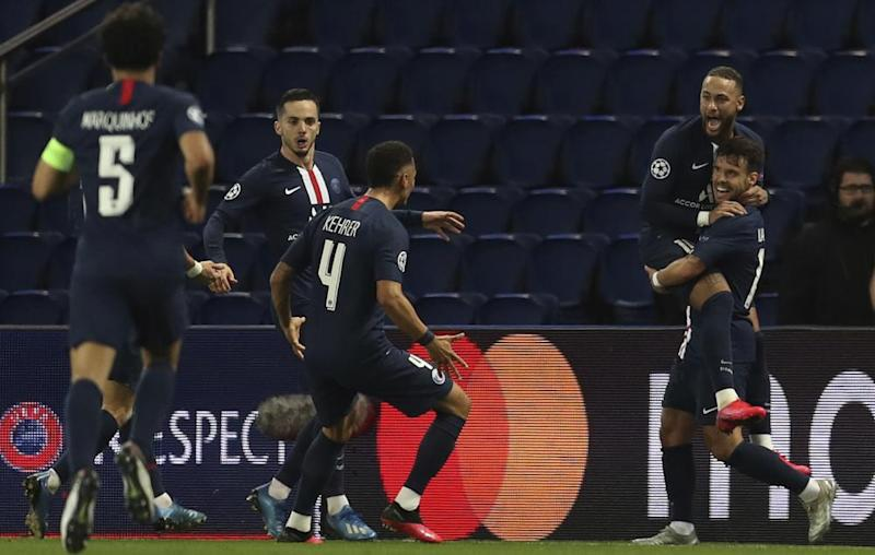 PSG's Juan Bernat celebrates with teammates after scoring the critical goal in March's last-16 second leg against Borussia Dortmund