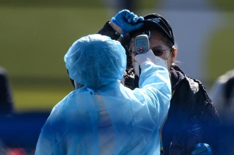 Japan has struggled to deal with the fallout from a cruise ship that it quarantined off its coast, where more than 700 people tested positive for the virus (AFP Photo/Philip FONG)