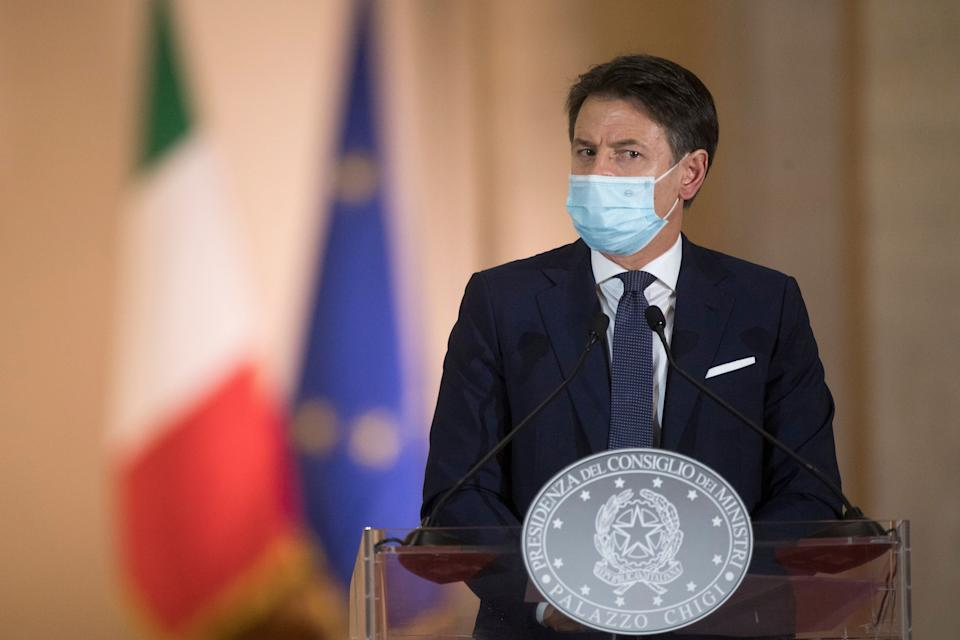 ROME, ITALY - OCTOBER 18: Italy's Prime Minister Giuseppe Conte announces new safety measures following a national surge of COVID-19 infections during a press conference at Palazzo Chigi on October 18, 2020 in Rome, Italy. Following this announcement local mayors will have the power to close public areas after 9pm with restaurant opening times and group sizes also being tightened. Bars and restaurants will have to close at midnight and after 6pm, only table service will be allowed, with maximum group sizes being six. Conferences and local festivals have been suspended and amateur contact sports will be stopped while gyms and swimming pools will have seven days to adapt to the new protocols. Starting times at schools will be later and more distance-learning will be encouraged, although these will mainly affect older pupils in high schools. Today Italy has registered 11705 new positive cases with 69 deaths. (Photo by Alessandra Benedetti - Corbis/Getty Images) (Photo: Alessandra Benedetti - Corbis via Getty Images)