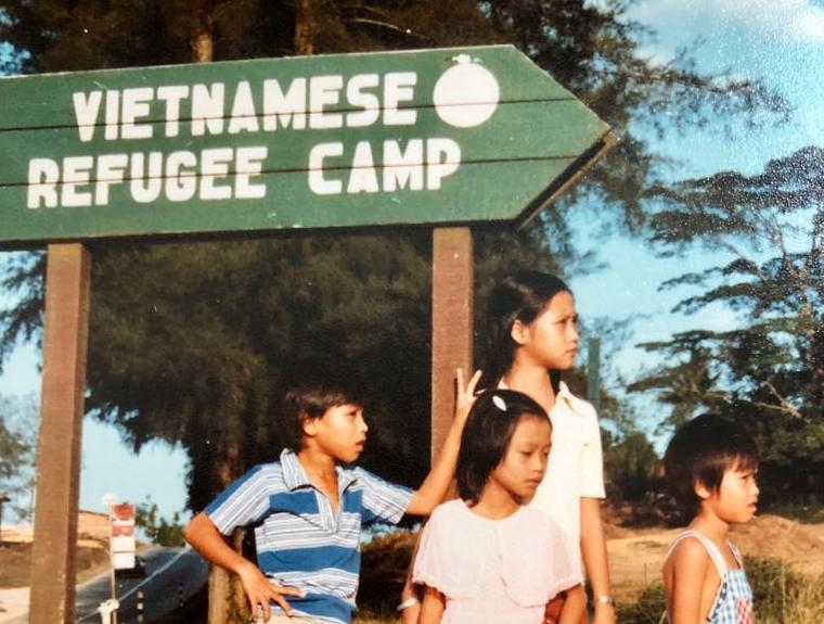 12-year-old Cristal Lim, née Tran (middle) with her three siblings at the former Vietnamese refugee camp in Hawkins Road, Sembawang, in 1981.   PHOTO: Cristal Lim