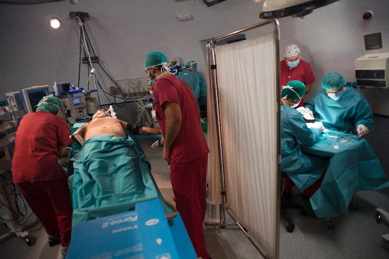 Patient Juan Benito Druet is prepared for surgery -- Spain has lead the world in organ transplants for 25 years