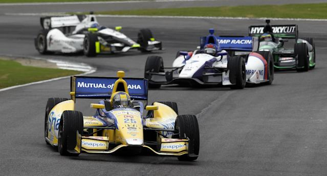 Marco Andretti (25) leads a pack of cars out of turn 16 during the Indy Grand Prix of Alabama auto race on Sunday, April 27, 2014, in Birmingham, Ala. (AP Photo/Butch Dill)