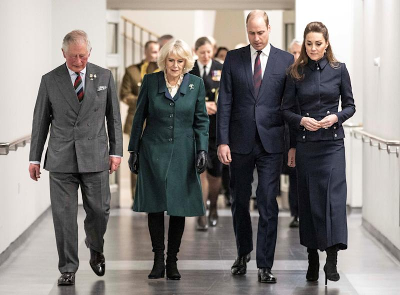 Britain's Prince William, Duke of Cambridge (2R) and his wife Britain's Catherine, Duchess of Cambridge (R) talk with his father Britain's Prince Charles, Prince of Wales (L) and his wife Britain's Camilla, Duchess of Cornwall (2L) during their visit to the Defence Medical Rehabilitation Centre (DMRC) in Loughborough, central England on February 11, 2020. - The DMRC currently provides services to a small group of veterans in the form of the Complex Prosthetic Assessment Clinic (CPAC), which is a joint MOD and NHS England commissioned outpatient clinic. (Photo by Richard Pohle / POOL / AFP) (Photo by RICHARD POHLE/POOL/AFP via Getty Images)