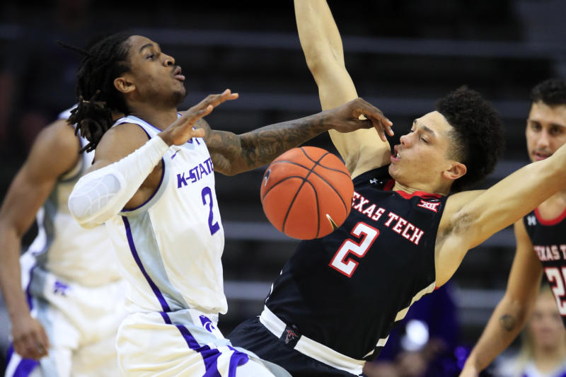 Kansas State guard Cartier Diarra, left, is fouled by Texas Tech guard Clarence Nadolny, right, during the first half of an NCAA college basketball game in Manhattan, Kan., Tuesday, Jan. 14, 2020. (AP Photo/Orlin Wagner)