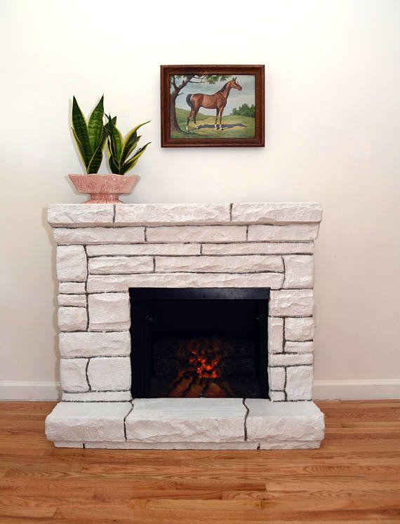 """No fireplace? No problem. This faux stone electric fireplace will cozy up any roomjust the same, chimney accessories not required. <a href=""""https://www.etsy.com/listing/539563793/white-faux-stone-electric-fireplace-and?ref="""" target=""""_blank"""">Shop it here</a>."""