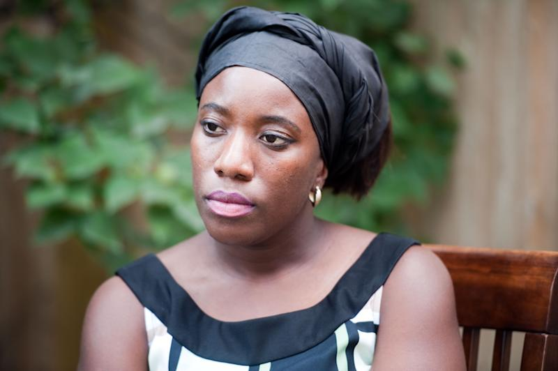 Decontee Sawyer, wife of Liberian government official Patrick Sawyer, a naturalized American who died from Ebola after traveling from Liberia to Nigeria, talks with a reporter at her home in Coon Rapids, Minn., Tuesday, July 29, 2014. An outbreak of Ebola in West Africa may seem like a distant threat to many Americans, but it is stirring fear in Minnesota, home to thousands of Liberian immigrants. (AP Photo/Craig Lassig)