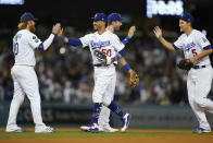 From left, Los Angeles Dodgers third baseman Justin Turner (10), right fielder Mookie Betts (50), second baseman Trea Turner (6), and shortstop Corey Seager (5) celebrate after a 3-0 win over the San Diego Padres in a baseball game Friday, Sept. 10, 2021, in Los Angeles. (AP Photo/Ashley Landis)