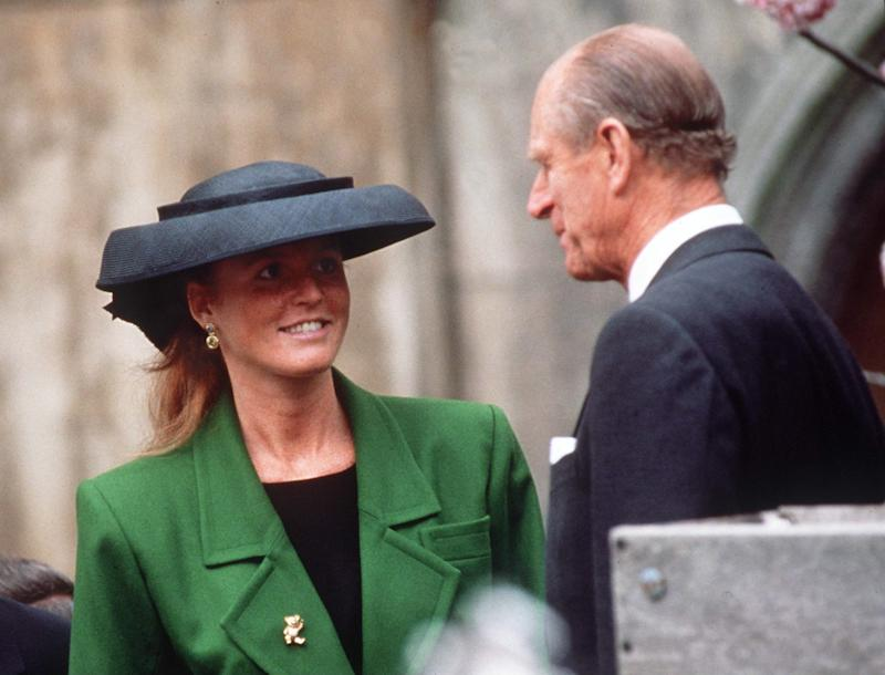 Sarah Ferguson in a green coat and black hat with Prince Philip